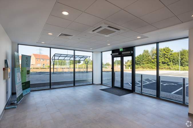 Ground floor reception area with access to warehouse, toilets, stairs and lift to first floor. - Dartford X, Unit A, Dartford - Industrial unit for rent - 75,277 sq ft